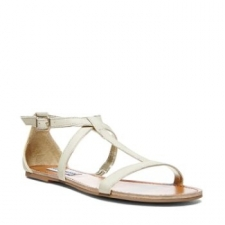 Get for beach season and poolside-lounging in this sleek flat. Strappy sandal features glossy straps and metallic embellishments. So fabulously on-trend! Man-made upper Man-made sole Man-made lining