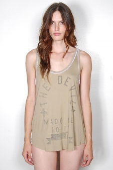The Rebel Yell Devil Made Me Do It Cinder Tank in Khaki is a light weight rib tank with a raw edge, round bottom hem and white lace detailing around the scoop neck. This piece features a reverse, black screen print on the front and is completed with a vintage wash.