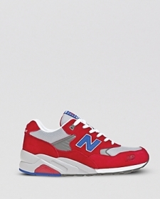 The New Balance Elite Edition Barbershop Pack 580 Sneaker in Red Surpass the competition in the Elite Edition Barbershop Pack 580 Sneaker in Red. Boasting a red suede upper with silver-grey mesh panels a ROLLBAR midsole a traction outsole and unique details that nod to the classic barbershop like striped aglets and checkerboard insoles these athletic kicks are the newest and hottest offering by New Balance. Low top Suede and mesh upper Cushioned ankle collar and tongue Punched eyelets Contrast laces Striped aglets Contrast emblems foxed on sides Contrast logo embroidered on rear ankle ROLLBAR midsole Checkerboard insole Traction outsole Leather and man-made materials Imported By New Balance