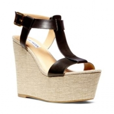Take a stand in this flirty favorite! The woven wedge comes to life with chic espadrille platform. Features front leather t-strap detailing with ankle strap. Rock with a floral printed dress, denim jacket and some beachy hair waves. 4.5 inch heel 2 inch platform Man-made upper Man-made lining Man-made sole