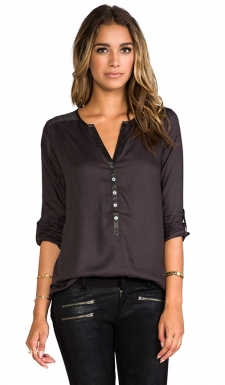 You will inevitably fall in love with this new collection from the designers that brought you Joie. Soft Joie is a line of not-so-basic basics, with the softest blends of modal and other comfortable fabrics that will keep you comfortable and chic. 100% viscose. Front button placket. Rolled tabbed sleeves. Asymmetric hem.