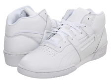 Even though we've all outgrown our shaggy long hair, traded in our record player for MP3's, leather rock-n-roll pants for premium denims, some things will always hold their nostalgic value-like these Workout Mid sneakers from Reebok Classics! Soft leather upper.A midfoot H-strap provides custom fit and support. Foam-padded collar. Textile lining and a cushioned footbed for all-day comfort. Traditional lacing system with a padded tongue for optimal fit. Embossed Reebok logo on outer heel, side panels and leather tongue label. Perforated toe-box detail. Rubber outsole for grip. Imported. Measurements: Weight: 1 lb 1 ozProduct measurements were taken using size 11.5, width D - Medium. Please note that measurements may vary by size.