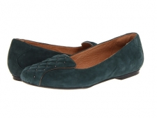 Add this luxe beauty to your fall wardrobe and match it with a flowy skirt or your favorite jeans! Suede upper with metallic studs and piping. Slip-on allows for easy on-and-off wear. Leather lining ensures an abrasion-free environment for all-day wear. Ortholite® footbed provides additional cushioning for all-day comfort. Rubber outsole delivers long-lasting durability on a variety of surfaces. Imported. Measurements: Heel Height: 1 2 inWeight: 8 ozProduct measurements were taken using size 8.5, width B - Medium. Please note that measurements may vary by size.