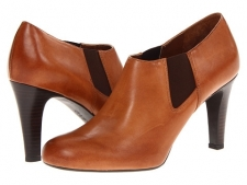 Celebrate style with these sleek pumps! Easy slip-on wear. Polished leather upper. Man-made lining. Lightly cushioned man-made footbed. Wrapped heel. Man-made sole. Imported. Measurements: Heel Height: 3 1 2 inWeight: 9 ozProduct measurements were taken using size 9, width M. Please note that measurements may vary by size.