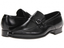 These sleek loafers are every man's must-have. Leather upper. Slip-on construction. Sleek vamp strap with metal hardware. Leather lining. Lightly cushioned footbed. Synthetic sole. Imported. Measurements: Heel Height: 1 inWeight: 14 ozProduct measurements were taken using size 9.5, width EE. Please note that measurements may vary by size.
