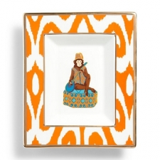 Exhilarated by the experience of traveling the world, our design team translated iconic animal imagery and rich history from around the globe into a beautiful home accent. Our decorative porcelain plate portrays a playful monkey in traditional bejeweled dress, framed in a charming scroll ikat border with golden trim. Perfect for holding light snacks or hanging on your walls!