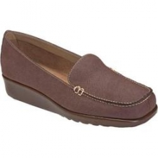 """The exact point where style meets comfort. Lounge-worthy loafer with a 1 1/4"""" wedge boasts a stitched upper with accent hardware that is chic and cool. Scored sole is flexible and plush, forming a comforting barrier between your foot and the ground. Heel Height: 1 1/4"""" Origin: Imported Fit: True to Size Outsole: Rubber Upper: Faux Leather, Faux Suede Special Features: Wedge"""