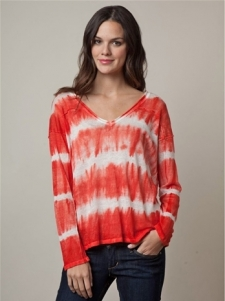 The Tie Dye V-Neck is a loose fitting style with long sleeves and v neck. Horizontal tie dye design on body.