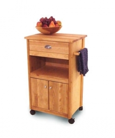 Modified Cuisine cart is a great addition to your kitchen decor Furniture features solid birch tops, braces, legs and doors Cart has finely matched warp-resistant birch veneer sides, shelves, and back panels Large drawer Bottom shelf Heavy duty locking casters Satin nickel hardware Oil finish Several years ago when hard maple became short in supply, we searched for a hardwood with a distinctive grain and color that would complement woods found in most kitchens. We chose birch - a beautiful Northeastern hardwood - and offer it here in this attractive butcher block cart Cart measures 22 1/8 inches wide x 15-1/4 inches deep x 34 inches high; height top size: 24 inches wide x 15 1/4 inches long Enclosed with adjustable middle shelf Avoid placing your furniture in direct sunlight and maintain at least two feet between furniture and heat sources. Aniline and Protected leathers are especially sensitive to direct sunlight. Use a professional cleaner to help resist staining and prevent overall soiling. For oil based stains, use a professional degreaser.
