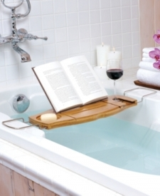 Relax in luxury with the Aquala Bathtub Caddy by Umbra. Constructed of natural bamboo and chrome-plated stainless steel, this deluxe caddy features a built-in wine glass holder (fits most standard stemware glasses), a book prop for reading material, and a self-draining soap dish. The metal arms extend up to 37 inches across to span a variety of tub widths. Slide in the arms and fold down the book prop for compact storage when not in use. The natural bamboo is fully sealed and will not split or discolor in moisture. Designed by Luciano Lorenzatti for Umbra, a leader in innovative, modern, and affordable design for the home Set includes: One (1) bathtub caddy Color: Natural bamboo Materials: Bamboo/ metal Texture: Smooth Dimensions: 1.5 inches high x 28-37 inches wide x 8.5 inches deep The digital images we display have the most accurate color possible. However, due to differences in computer monitors, we cannot be responsible for variations in color between the actual product and your screen.