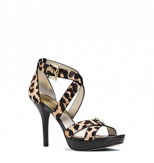 The Evie is one standout sandal. Designed in cheetah-print calf hair and leather with a stiletto heel this luxe leg-lengthening pair grounds everything from full skirts to LBDs with animalistic allure. Size: 9.5. Color: Natural.
