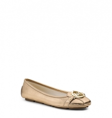 Classic contemporary cult-worthy-the Fulton flat is a true favorite. Inspired by a moccasin silhouette we updated this style in glossy metallic leather and topped it off with our logo charm. Sleek enough to fit into your tote this pair is ideal for commutes and cross-town errands. Size: 9.5. Color: Pale Gold.