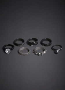 Ring set in black, hematite and silver tone Details include spikes, rhinestones and etching Base metals Imported